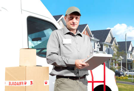 Happy professional shipping courier. Delivery postal service. photo