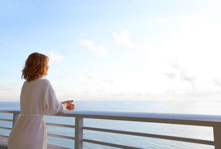 Happy woman looking on the ocean Stock Photo - 15594041