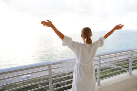 Happy woman looking on the ocean