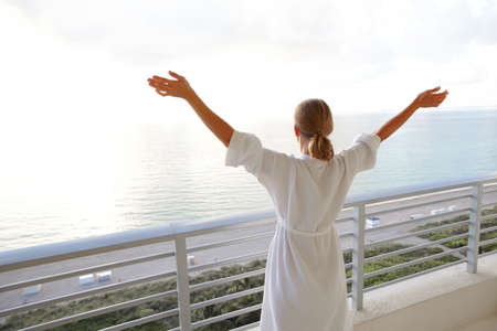 Happy woman looking on the ocean Stock Photo - 15594045