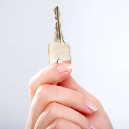 Hand with a house key  photo