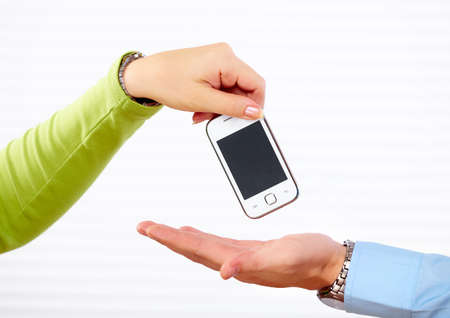 Hands of woman with a smartphone