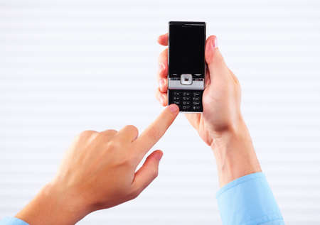Hands of woman with a smartphone Stock Photo - 15705650