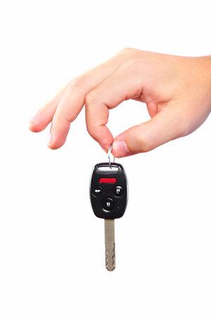 car keys: Hand with a car key