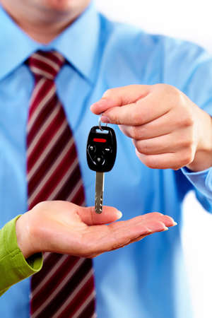 car dealers: Hand with a car key