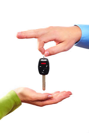 Hand with a car key
