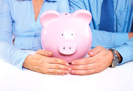 economizing: Couple with a piggy bank  Stock Photo
