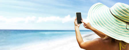 woman on phone: Happy beautiful woman on the beach. Vacation. Stock Photo