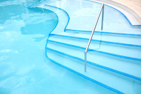 Swimming pool ladder. Luxury hotel resort. photo