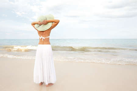 luxuries: Happy beautiful woman on the beach. Vacation. Stock Photo