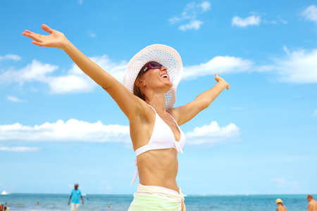 Happy beautiful woman on the beach. Vacation. Stock Photo - 16277190