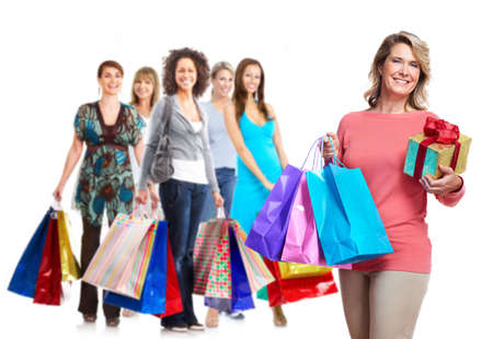 Senior woman with shopping bags. Isolated over white background. photo