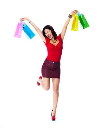 Shopping woman with bags isolated on white background. photo