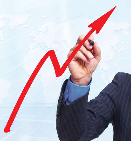Hand with a graph. Business concept background. Stock Photo - 16080676