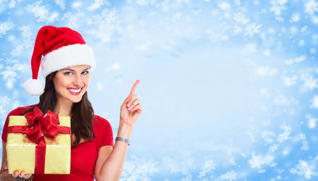 Beautiful happy Christmas Santa woman with gift  photo