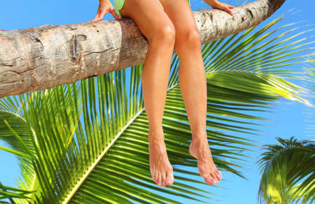 mexican girl: Woman legs on the beach