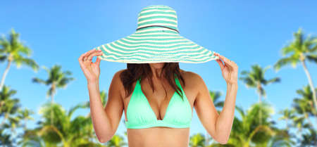 Beautiful woman in bikini and a hat  Stock Photo - 16185154