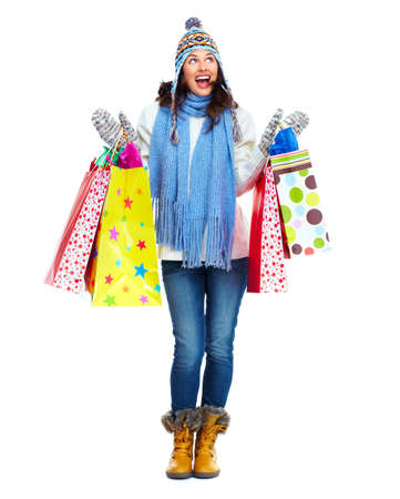 Beautiful shopping Christmas woman with bags  Banco de Imagens