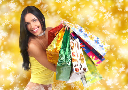 Beautiful christmas girl with shopping bags  photo