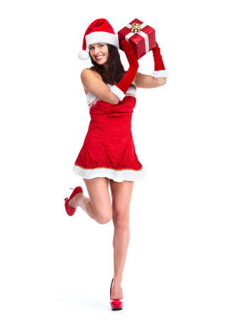 sexy santa girl: Santa helper Christmas girl with a present  Stock Photo