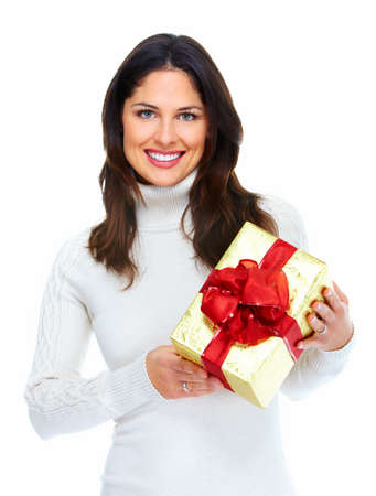 Beautiful young Christmas girl with gift