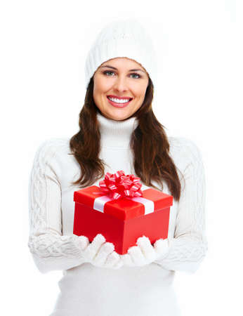 Beautiful young Christmas girl with gift  photo