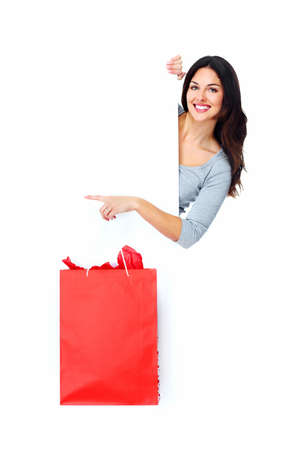 Beautiful shopping Christmas woman with bag