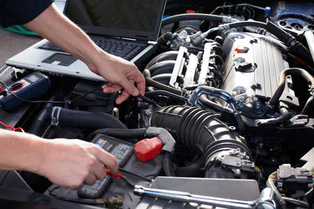 car service: Car mechanic working in auto repair service