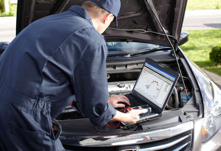 laptop repair: Car mechanic working in auto repair service