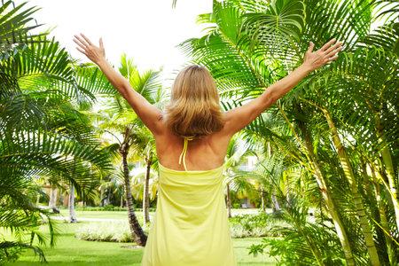 Woman in the tropical garden Stock Photo - 16336372