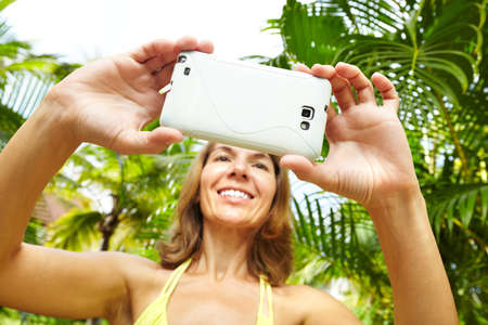 Woman with a smartphone  Stock Photo - 16336311