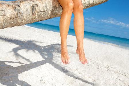 Woman legs on the beach Stock Photo - 16417417