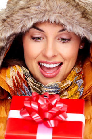 Beautiful young Christmas girl with a present Stock Photo - 16336326