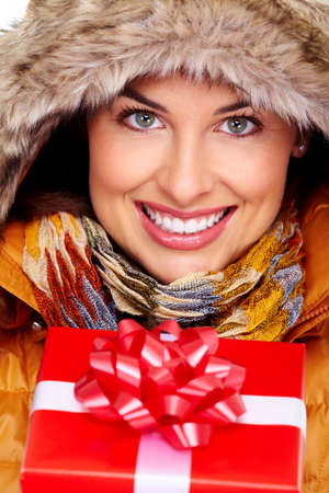Beautiful young Christmas girl with a present Stock Photo - 16336324