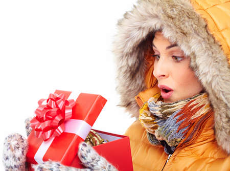 Beautiful young Christmas girl with a present Stock Photo - 16336251