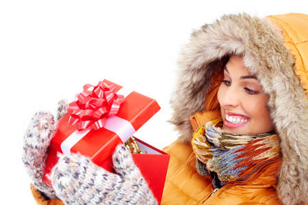 Beautiful young Christmas girl with a present  Stock Photo - 16336255