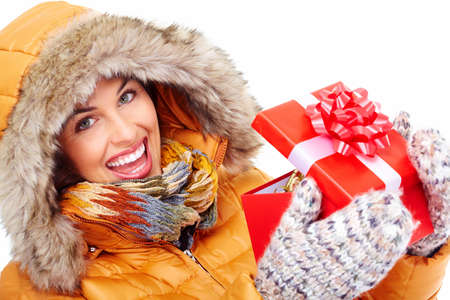Beautiful young Christmas girl with a present  Stock Photo - 16336317