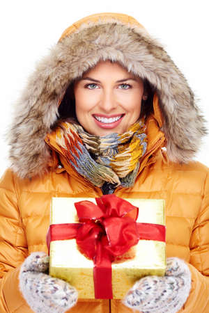 winter fashion: Beautiful young Christmas girl with a present