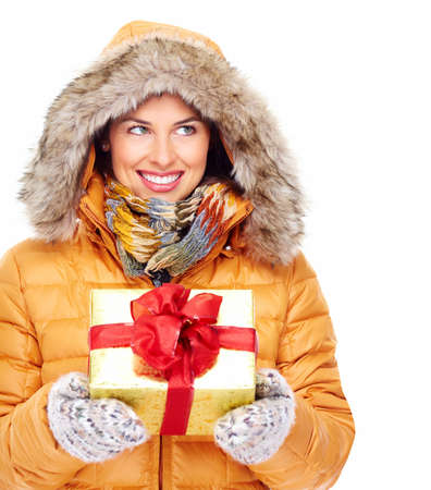 Beautiful young Christmas girl with a present  Stock Photo - 16336318