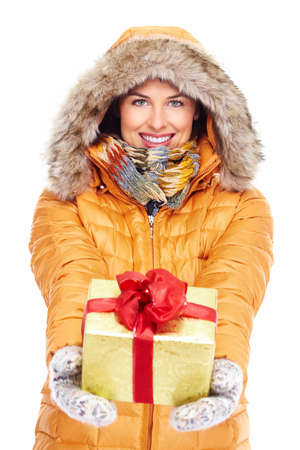 Beautiful young Christmas girl with a present  Stock Photo - 16336308