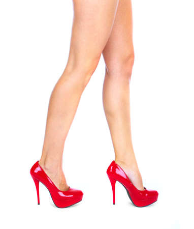 Woman legs with a red sexy shoes Stock Photo - 16417359