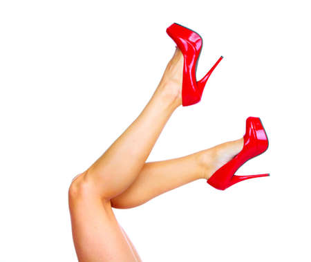 Woman legs with a red sexy shoes  Stock Photo - 16417329