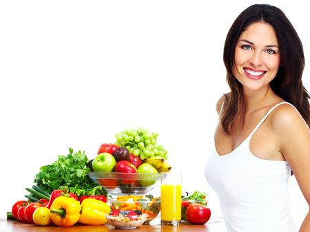 nutrici�n: Mujer joven sana con frutas Foto de archivo