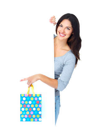 Beautiful shopping Christmas woman with bag  photo
