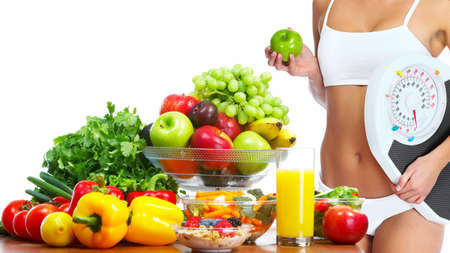 fat belly: Young healthy woman with fruits