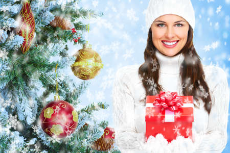 Beautiful young Christmas girl with a present  Stock Photo - 16336325
