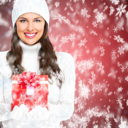 Beautiful young Christmas girl with a present Stock Photo - 16336230