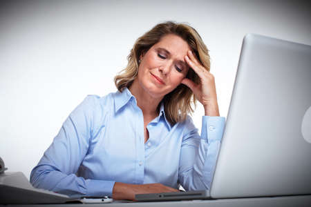 Business woman having a headache  Stock Photo - 16336247