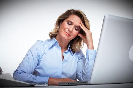 Business woman having a headache Stock Photo - 16336247