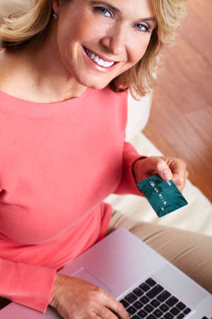 Woman with laptop and a credit card  Stock Photo - 16336252